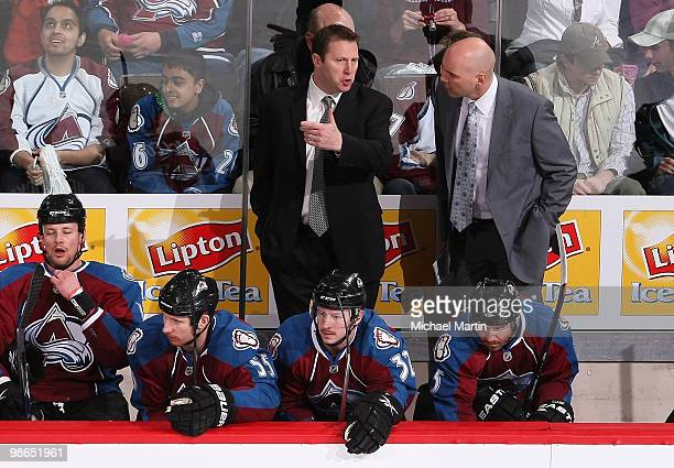 Head coach Joe Sacco left of the Colorado Avalanche talks with Sylvain Lefebvre against the San Jose Sharks in game Six of the Western Conference...