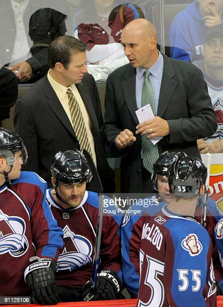 Head coach Joe Sacco of the Colorado Avalanche and assistant coach Sylvain Lefebvre talk as they lead their team against the Los Angeles Kings during...