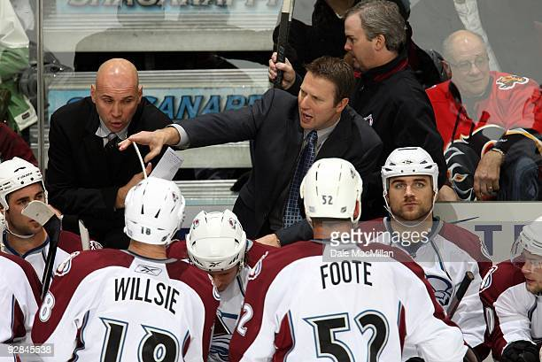 Head Coach Joe Sacco of the Colorado Avalanche instructs his players from the bench area during their game against the Calgary Flames on October 28...