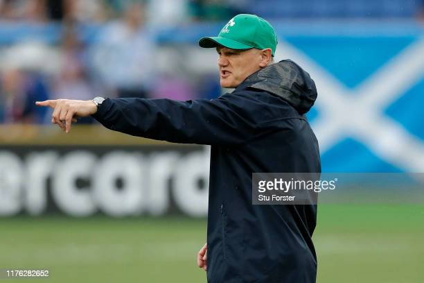 Head coach Joe Schmidt instructs players during the warm up prior to the Rugby World Cup 2019 Group A game between Ireland and Scotland at...