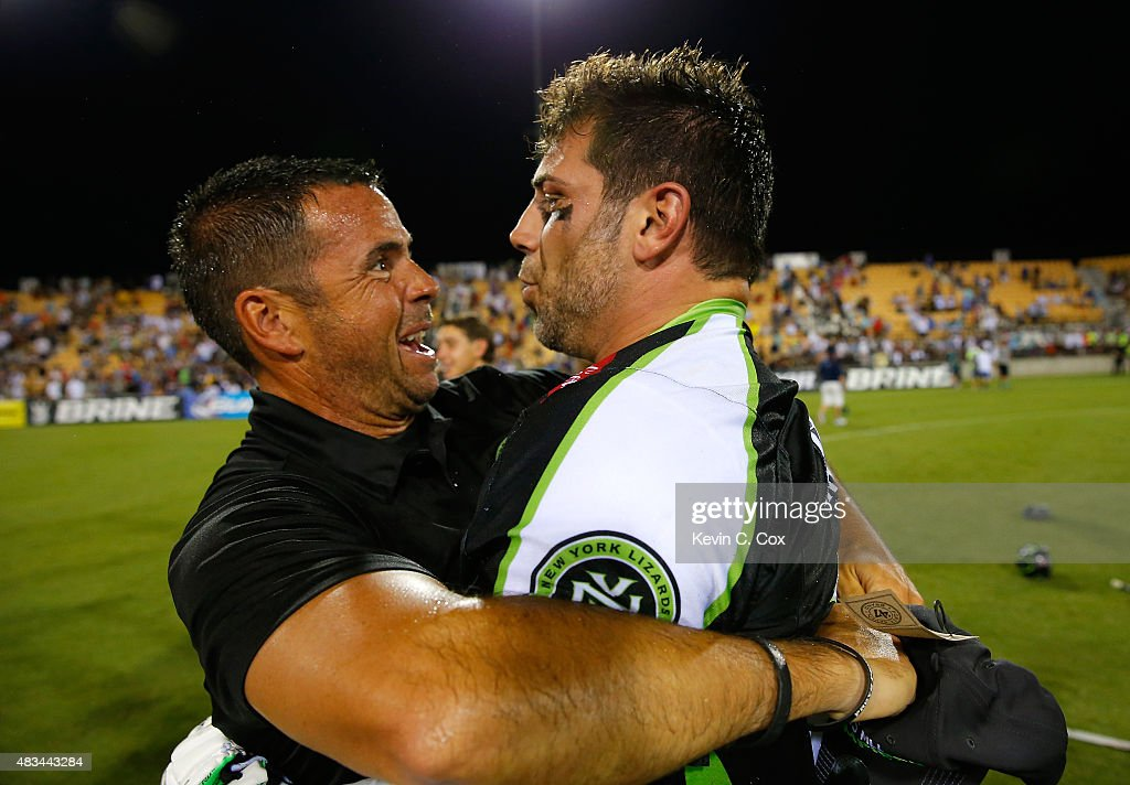 Head coach Joe Spallina of the New York Lizards celebrates with Greg Gurenlian #32 after their 15-12 win over the Rochester Rattlers during the 2015 Major League Lacrosse Championship Game at Fifth Third Bank Stadium on August 8, 2015 in Kennesaw, Georgia.