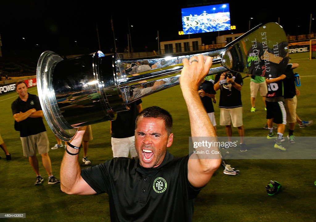 Head coach Joe Spallina of the New York Lizards celebrates with the trophy after their 15-12 win over the Rochester Rattlers during the 2015 Major League Lacrosse Championship Game at Fifth Third Bank Stadium on August 8, 2015 in Kennesaw, Georgia.