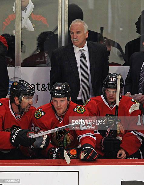 Head coach Joel Quenneville of the Chicago Blackhawks along with Andrew Brunette Bryan Bickell and Marcus Kruger watch from the bench as the...