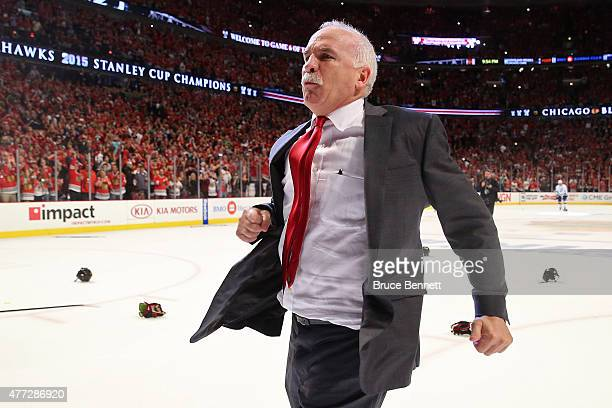 Head coach Joel Quenneville of the Chicago Blackhawks celebrates after defeating the Tampa Bay Lightning by a score of 20 in Game Six to win the 2015...