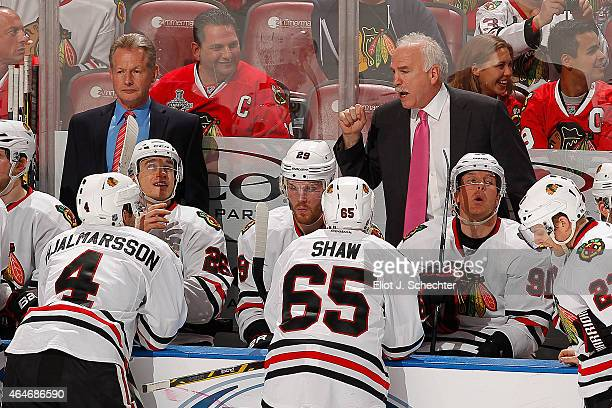 Head Coach Joel Quenneville of the Chicago Blackhawks directs his team from the bench along with Assistant Coach Mike Kitchen against the Florida...