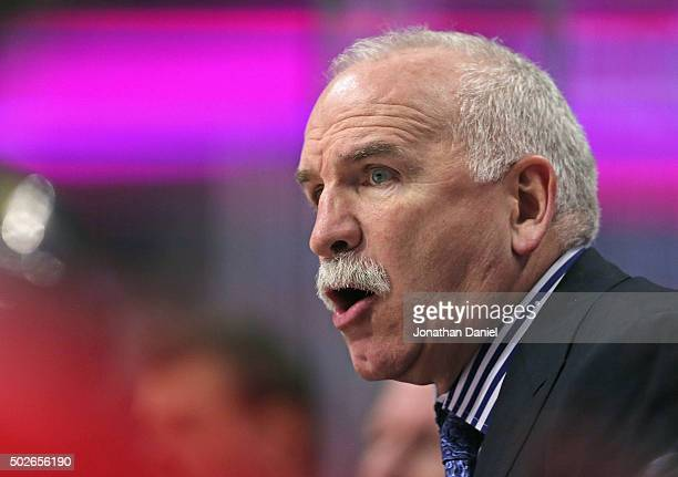 Head coach Joel Quenneville of the Chicago Blackhawks gives instructions to his team against the Carolina Hurricanes at the United Center on December...