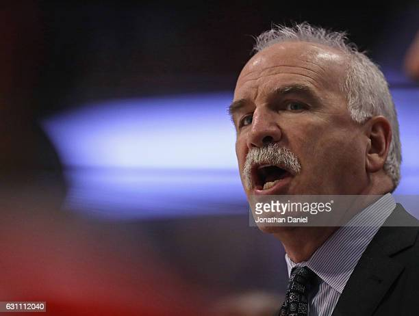 Head coach Joel Quenneville of the Chicago Blackhawks gives instructions to his team during a ganme against the Carolina Hurricanes at the United...
