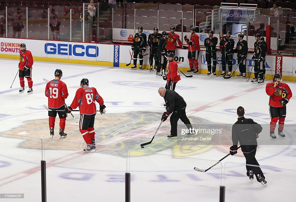 Head coach Joel Quenneville of the Chicago Blackhawks (center) leads the team during practice before the 2013 NHL Stanley Cup media day at the United Center on June 11, 2013 in Chicago, Illinois.