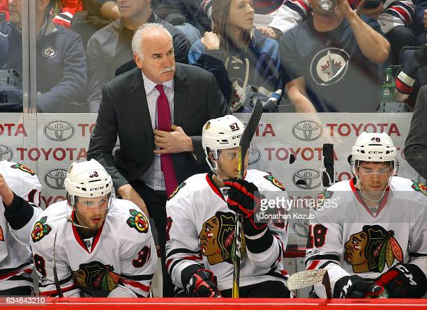 Head Coach Joel Quenneville of the Chicago Blackhawks looks on from the bench during third period action against the Winnipeg Jets at the MTS Centre...