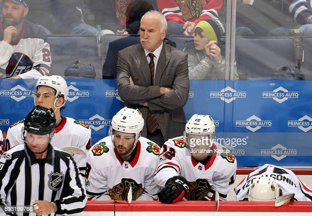 Head Coach Joel Quenneville of the Chicago Blackhawks looks on from the bench during second period action against the Winnipeg Jets at the Bell MTS...