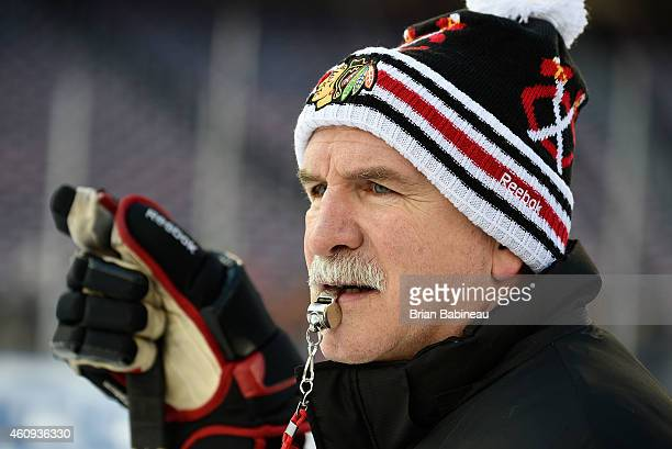 Head Coach Joel Quenneville of the Chicago Blackhawks oversees practice during practice day prior to the 2015 Bridgestone NHL Winter Classic on...