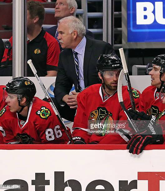 Head coach Joel Quenneville of the Chicago Blackhawks presides over his 800th career victory as a coach against the Boston Bruins at the United...