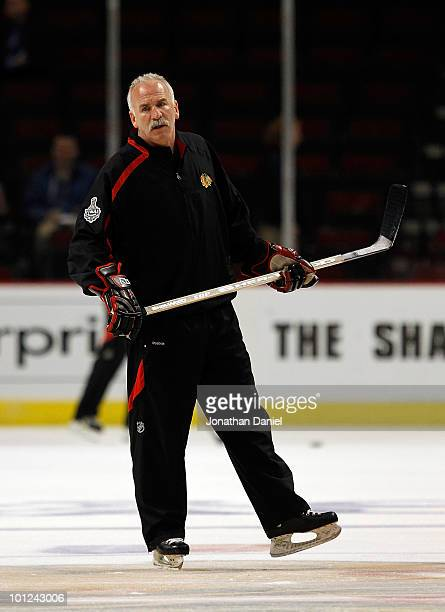 Head coach Joel Quenneville of the Chicago Blackhawks watches his team skate during Stanley Cup practice at the United Center on May 28 2010 in...