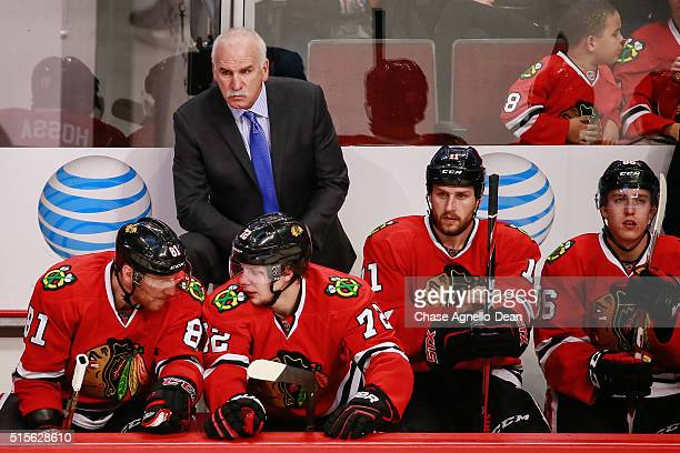 Head coach Joel Quenneville of the Chicago Blackhawks watches the action as Marian Hossa and Artemi Panarin talk in the second period of the NHL game...
