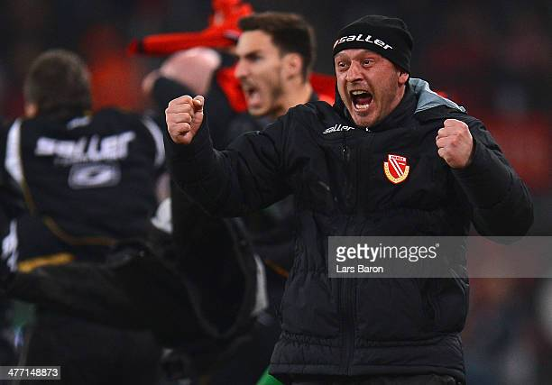 Head coach Joerg Boehme of Cottbus celebrates after Boubacar Sanogo scored his teams first goal during the Second Bundesliga match between 1. FC...