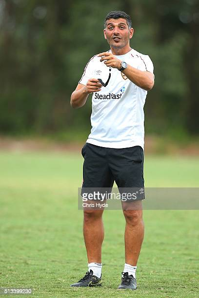 Head coach John Aloisi talks to players during a Brisbane Roar ALeague training session at Griffith University on March 3 2016 in Brisbane Australia