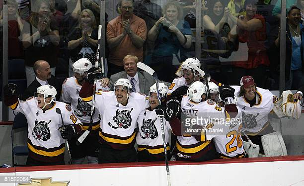 Head coach John Anderson of the Chicago Wolves celebrates with members of his team on the bench as they close out the WilkesBarre/Scranton Penguins...