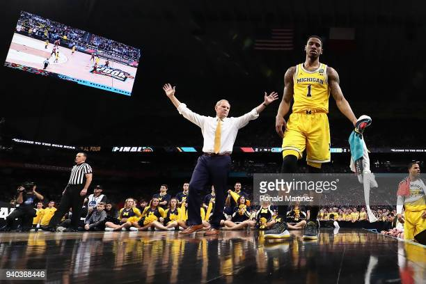 Head coach John Beilein and Charles Matthews of the Michigan Wolverines react in the first half against the Loyola Ramblers during the 2018 NCAA...