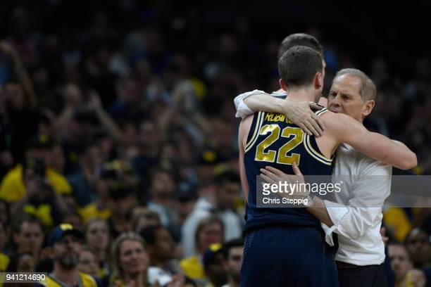 Head coach John Beilein and Duncan Robinson of the Michigan Wolverines hug after the 2018 NCAA Men's Final Four National Championship game against...