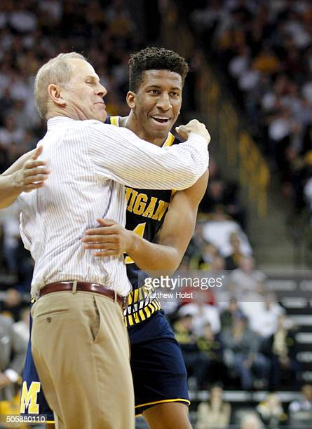 Head coach John Beilein hugs guard Aubrey Dawkins of the Michigan Wolverines during a timeout in the first half against the Iowa Hawkeyes on January...