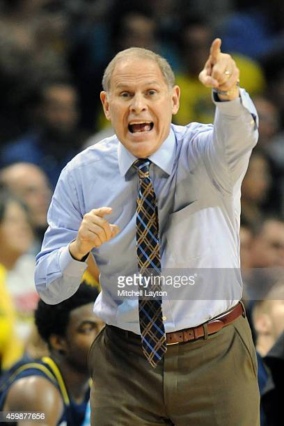 Head coach John Beilein of the Michigan Wolverines argues a call during the Progressive Legends Classic college basketball game against the Oregon...