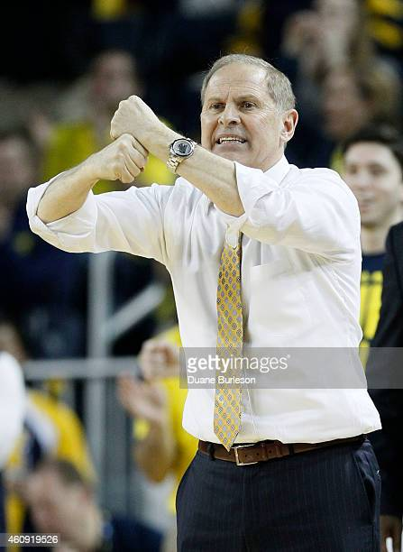 Head coach John Beilein of the Michigan Wolverines calls a play during overtime of a game against the Illinois Fighting Illini at Crisler Arena on...
