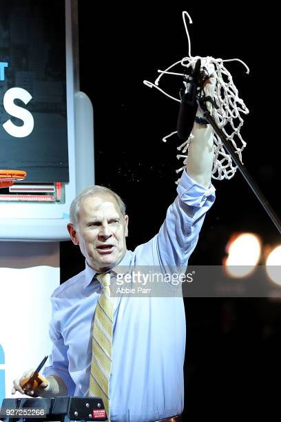 Head coach John Beilein of the Michigan Wolverines celebrates after defeating the Purdue Boilermakers 7566 during the championship game of the Big 10...