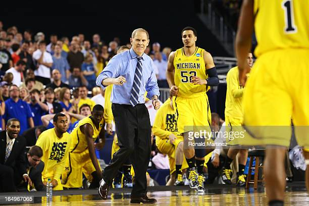 Head coach John Beilein of the Michigan Wolverines celebrates late in their 87 to 85 win over the Kansas Jayhawks in overtime during the South...