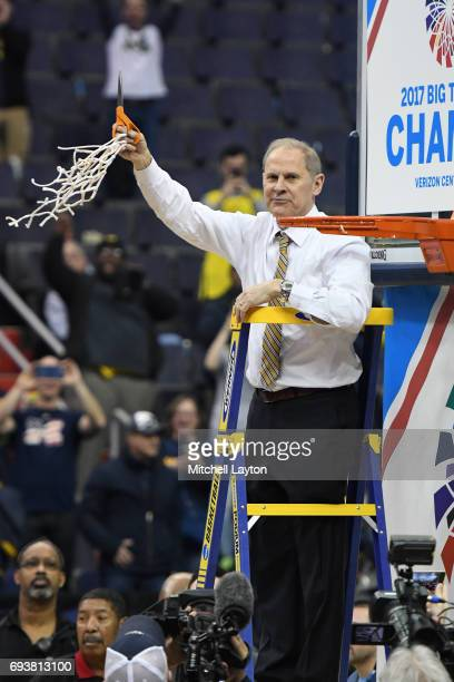 Head coach John Beilein of the Michigan Wolverines celebrates winning the Big Ten Men's Basketball Final against the Wisconsin Badgers at the Verizon...