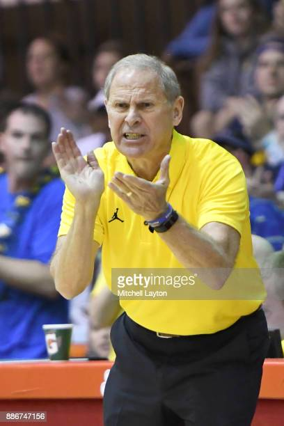 Head coach John Beilein of the Michigan Wolverines cheers his players during a quarterfinal college basketball game at the Maui Invitational against...