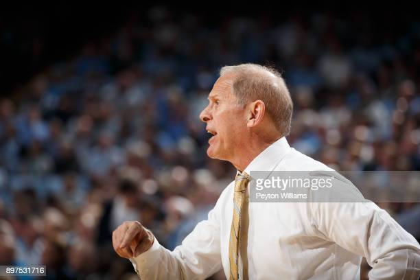 Head coach John Beilein of the Michigan Wolverines coaches against the North Carolina Tar Heels on November 29 2017 at the Dean Smith Center in...