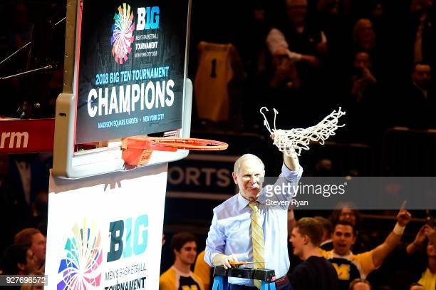 Head coach John Beilein of the Michigan Wolverines cuts down the net after a win over the Purdue Boilermakers in the championship game of the Big Ten...