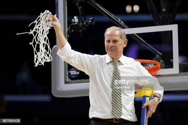 Head coach John Beilein of the Michigan Wolverines cuts down the net after the Wolverines 5854 victory against the Florida State Seminoles in the...