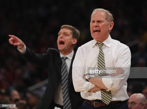 Head coach John Beilein of the Michigan Wolverines directs his team in the first half against the Nebraska Cornhuskers during quarterfinals of the...