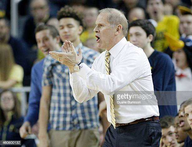 Head coach John Beilein of the Michigan Wolverines during the first half of a game against the Syracuse Orange at Crisler Arena on December 2 2014 in...
