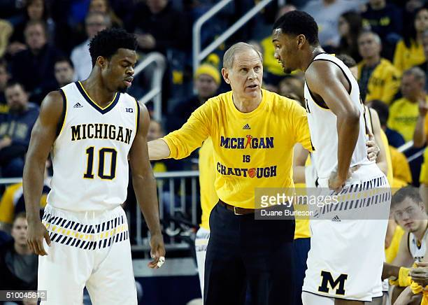 Head coach John Beilein of the Michigan Wolverines gives some directions to Derrick Walton of the Michigan Wolverines and Zak Irvin of the Michigan...