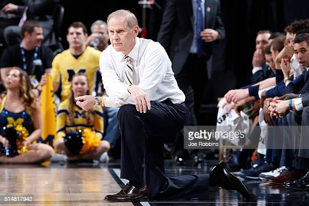 Head coach John Beilein of the Michigan Wolverines looks on against the Indiana Hoosiers in the quarterfinal round of the Big Ten Basketball...