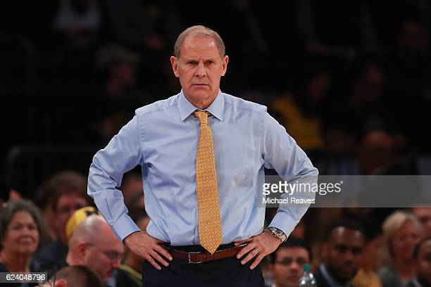 Head coach John Beilein of the Michigan Wolverines looks on against the Marquette Golden Eagles in the second half during the 2K Classic at Madison...