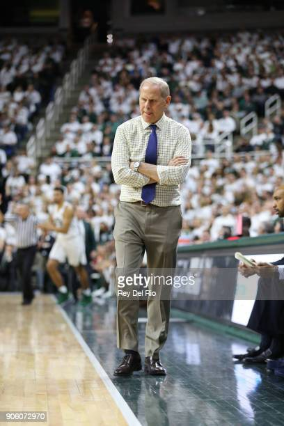 Head coach John Beilein of the Michigan Wolverines looks on during a game against the Michigan State Spartans at Breslin Center on January 13 2018 in...