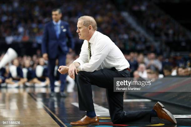 Head coach John Beilein of the Michigan Wolverines reacts against the Villanova Wildcats in the first half during the 2018 NCAA Men's Final Four...