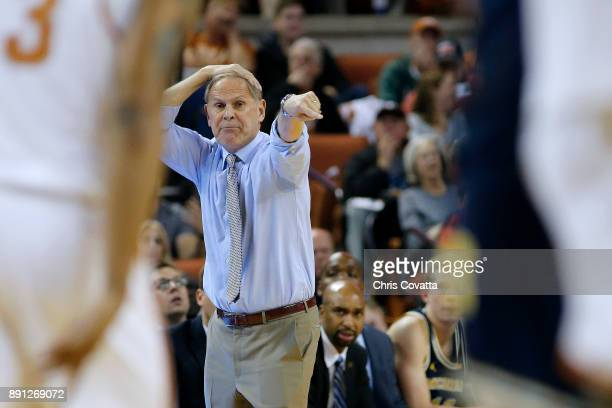 Head coach John Beilein of the Michigan Wolverines reacts as his team plays the Texas Longhorns at the Frank Erwin Center on December 12 2017 in...