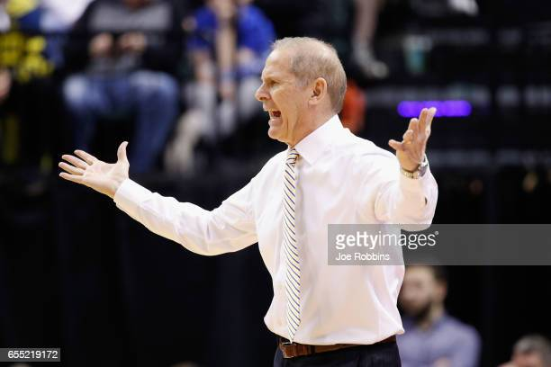 Head coach John Beilein of the Michigan Wolverines reacts in the first half against the Louisville Cardinals during the second round of the 2017 NCAA...
