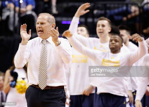 Head coach John Beilein of the Michigan Wolverines reacts in the second half against the Louisville Cardinals during the second round of the 2017...