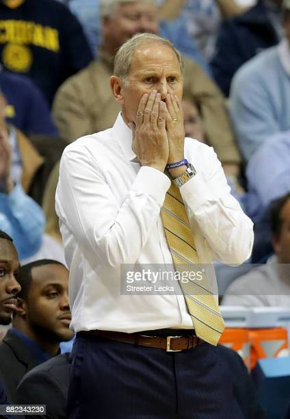 Head coach John Beilein of the Michigan Wolverines reacts on the bench against the North Carolina Tar Heels during their game at Dean Smith Center on...