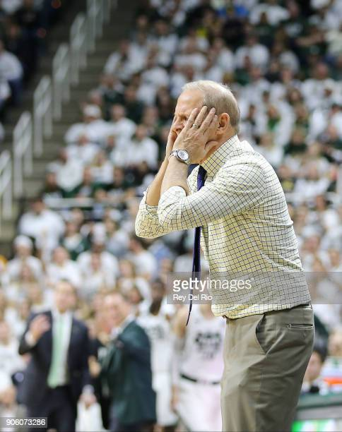 Head coach John Beilein of the Michigan Wolverines reacts to a call during a game against the Michigan State Spartans at Breslin Center on January 13...