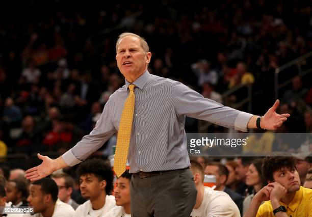 Head coach John Beilein of the Michigan Wolverines reacts to a foul against one of his players in the first half against the Iowa Hawkeyes during the...