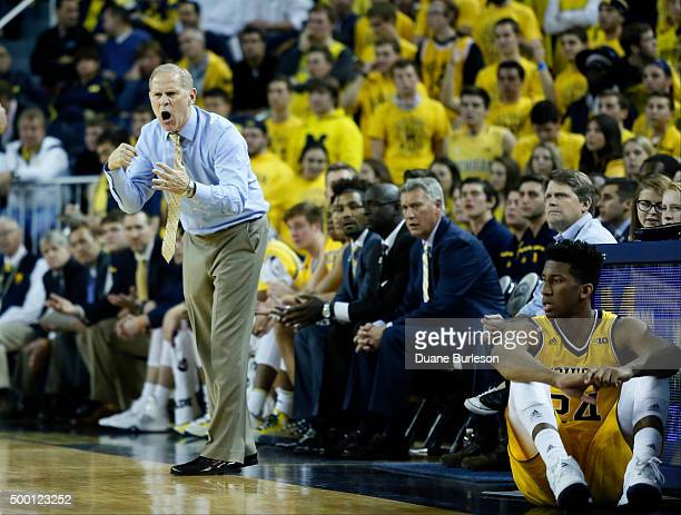 Head coach John Beilein of the Michigan Wolverines shouts instructions to his team during the second half of a game against the Xavier Musketeers at...