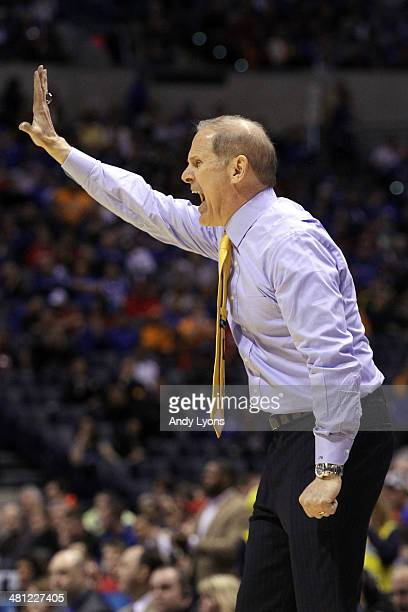 Head coach John Beilein of the Michigan Wolverines shouts to his team in the first half against the Tennessee Volunteers during the regional...