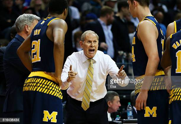 Head coach John Beilein of the Michigan Wolverines talks to his team in the second half against the Notre Dame Fighting Irish during the first round...