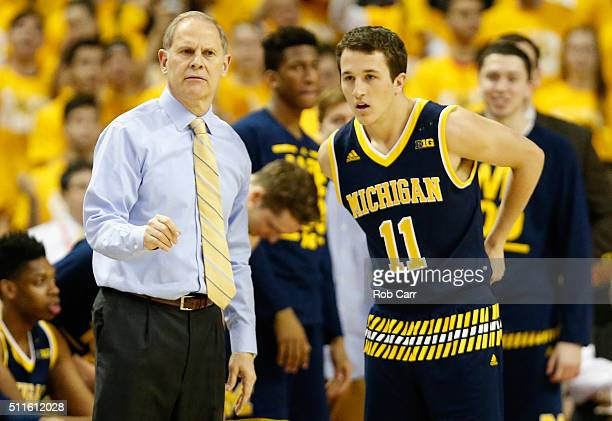 Head coach John Beilein of the Michigan Wolverines talks with Andrew Dakich during the second half against the Maryland Terrapins at Xfinity Center...